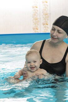 Baby swimming, mother with daughter in swimming pool - VGF00260