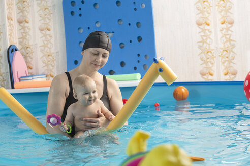 Baby swimming, mother with daughter in swimming pool - VGF00266