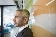 Profile of pensive businessman looking away - HEROF32729