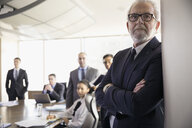 Serious attentive male lawyer listening in conference room meeting - HEROF32896