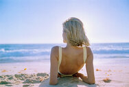 Serene woman laying on beach - JUIF00820
