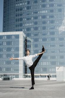 Artist practising on roof terrace - AFVF02648