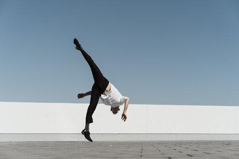 Artist practising on roof terrace - AFVF02654