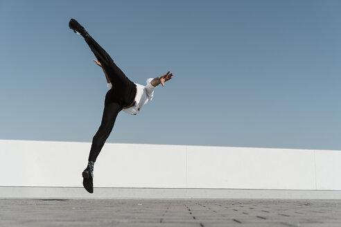 Artist practising on roof terrace - AFVF02660