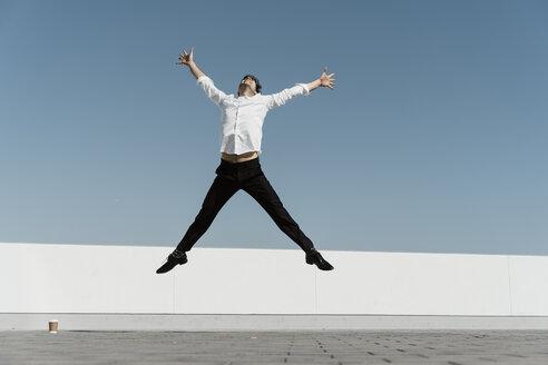 Artist practising on roof terrace - AFVF02666