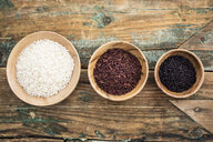 RIce, red rice, black rice in bowls, from above - GIOF05925