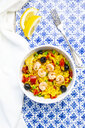 Paella with rice, bell pepper, tomato, artichoke, pea, black olive, curcuma and shrimps - LVF07939