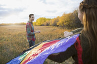 Couple flying a kite in autumn field - HEROF33287