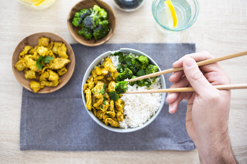 Curry chicken, broccoli and rice, man holding chopsticks with broccoli - GIOF06008