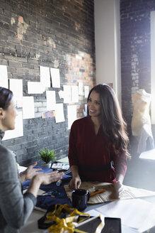 Female fashion designers brainstorming in office - HEROF33491