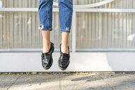 Feet of a teenage girl jumping midair - ERRF00866