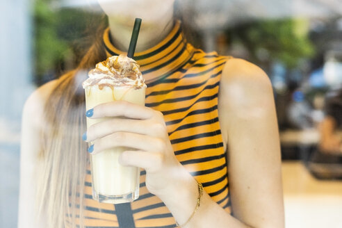Close-up of teenage girl drinking a milk shake - ERRF00869