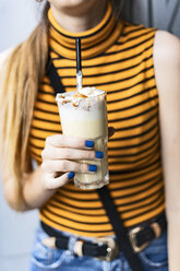 Close-up of teenage girl drinking a milk shake - ERRF00872