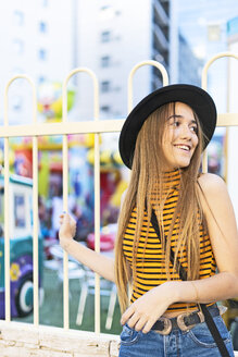 Spain, smiling teenage girl with hat - ERRF00881