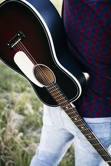 Close-up of man with a guitar - HMEF00272