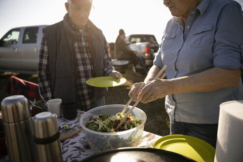 Senior farmers eating lunch, taking a break - HEROF33617