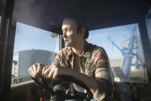 Female farmer driving tractor - HEROF33626