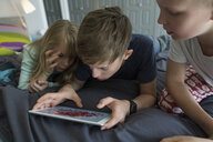 Brothers and sister using digital tablet - HEROF33776