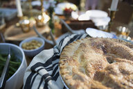 Close up of whole pie on buffet table at party - HEROF33872