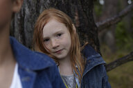 Portrait of redheaded girl at a tree - AMEF00061