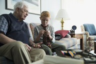 Grandfather teaching grandson how to tie a tie - HEROF33983