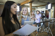 Creative businesswoman preparing to film tutorial - HEROF34265