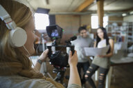 Creative business people filming tutorial - HEROF34268