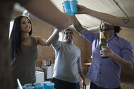 Creative business people celebrating toasting champagne in office - HEROF34283