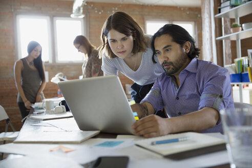 Designers using laptop in office - HEROF34298