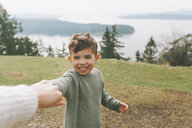 Boy holding mother's hand outdoors - CMSF00003