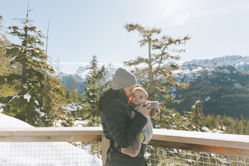 Mother holding her baby son on an observation deck, looking over Squamish, Canada - CMSF00030