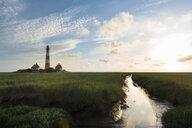 Germany, Westerhever, lighthouse in sunset - MKFF00481