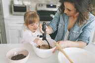 Mother and daughter making a cake together - CMSF00033