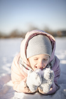 Portrait of little girl eating snow - EYAF00098
