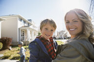 Portrait smiling mother holding son outdoors - HEROF34453