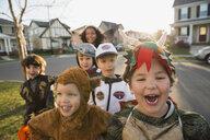 Portrait enthusiastic kids in Halloween costumes - HEROF34459