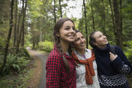 Mother and daughters hiking in woods - HEROF34498