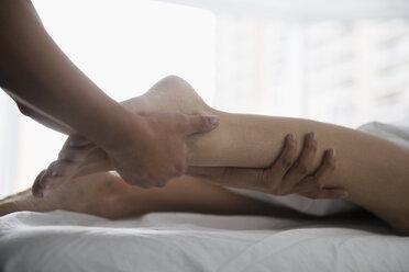 Woman receiving leg massage - HEROF34615