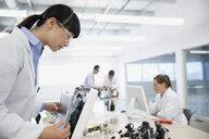 Engineer assembling computer in factory - HEROF34831