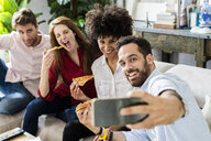 Freinds having fun, eating pizza together, taking selgies - GIOF06105