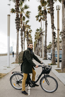 Portrait of man with e-bike on a promenade - JRFF02943