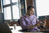 Businessman using digital tablet in office - HEROF34904
