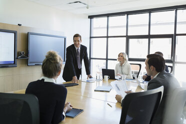 Businessman leading meeting in conference room - HEROF35021
