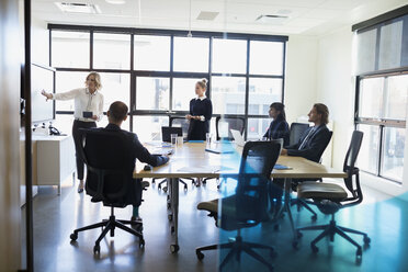 Businesswoman leading meeting in conference room - HEROF35024