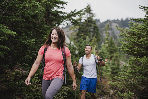 Couple hiking in woods - CAIF23068