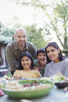 Portrait happy family at dinner table - CAIF23125