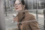 Portrait of businesswoman looking around - UUF17138