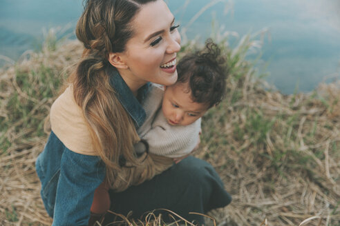 Mother holding her little daughter affectionately in nature - CMSF00051