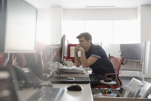 Focused businessman working in office - HEROF35315