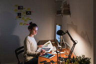 Woman working late at home - CUF49937